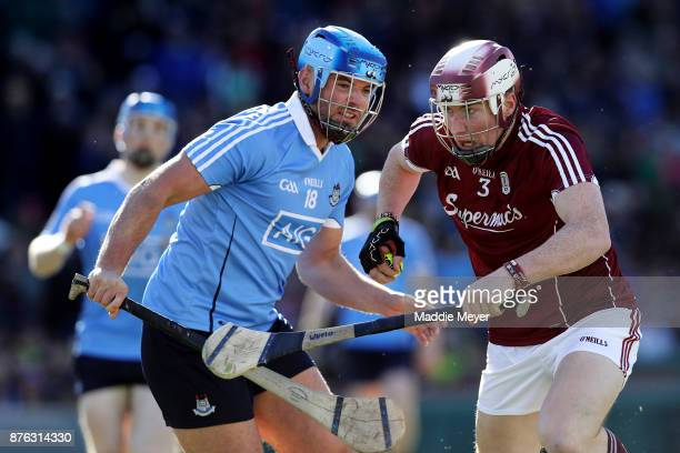 Ronan Smith of Dublin defends Conor Whelan of Galway in the match between Dublin and Galway during the 2017 AIG Fenway Hurling Classic and Irish...