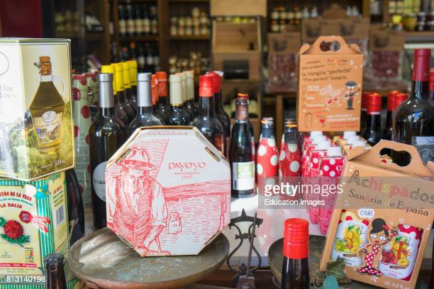 Ronda Malaga Province Andalusia southern Spain Display of typical foods and wine products in shop window Cheese sangria wine olive oil