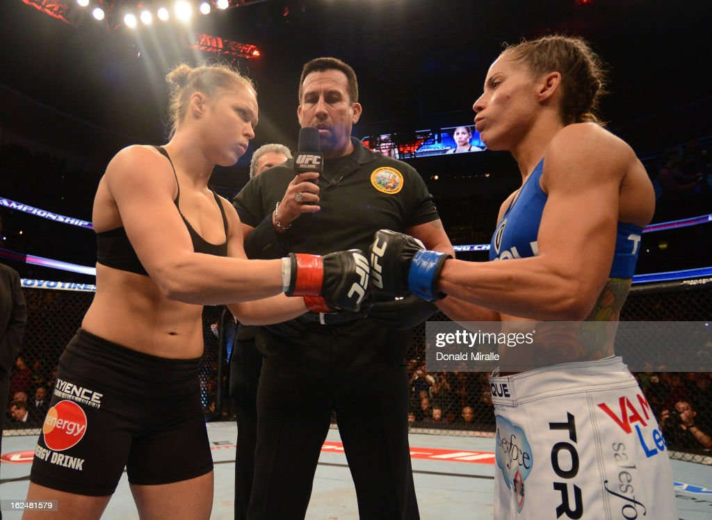 Ronda Rousey (left) and Liz Carmouche (right) touch gloves in their women's bantamweight title fight during UFC 157 at Honda Center on February 23, 2013 in Anaheim, California.