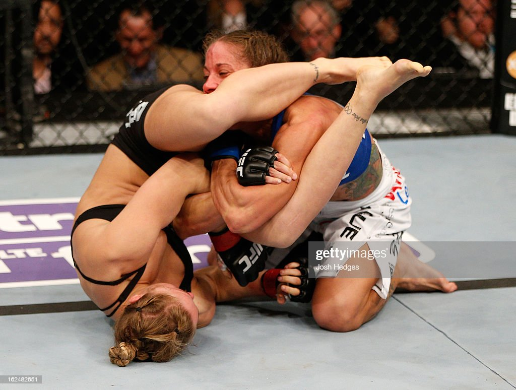 Ronda Rousey (left) attempts to submit Liz Carmouche in their women's bantamweight title fight during UFC 157 at Honda Center on February 23, 2013 in Anaheim, California.