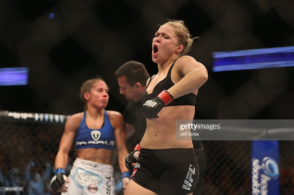 <a gi-track='captionPersonalityLinkClicked' href=/galleries/search?phrase=Ronda+Rousey&family=editorial&specificpeople=3009906 ng-click='$event.stopPropagation()'>Ronda Rousey</a> celebrates her UFC Bantamweight Title over <a gi-track='captionPersonalityLinkClicked' href=/galleries/search?phrase=Liz+Carmouche&family=editorial&specificpeople=7139916 ng-click='$event.stopPropagation()'>Liz Carmouche</a> at Honda Center on February 23, 2013 in Anaheim, California.