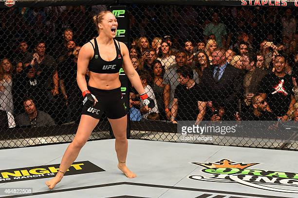 Ronda Rousey celebrates her victory over Cat Zingano in their UFC women's bantamweight championship bout during the UFC 184 event at Staples Center...