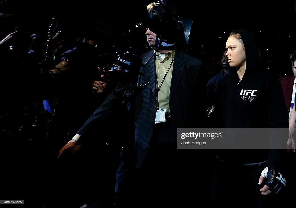 Ronda Rousey enters the arena before her UFC women's bantamweight championship bout against Miesha Tate during the UFC 168 event at the MGM Grand Garden Arena on December 28, 2013 in Las Vegas, Nevada.