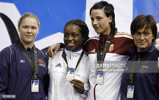 US Ronda Rousey France's Gevrise Emane Hugary's Anett Meszaros and Italy Ylenia Scapin celebrate on the podiun after the 70kg category final at the...