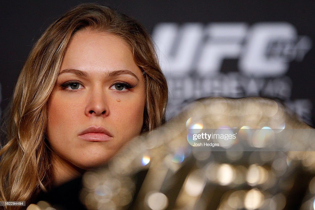 <a gi-track='captionPersonalityLinkClicked' href=/galleries/search?phrase=Ronda+Rousey&family=editorial&specificpeople=3009906 ng-click='$event.stopPropagation()'>Ronda Rousey</a> interacts with media during a UFC pre-fight press conference at Honda Center on February 21, 2013 in Anaheim, California.