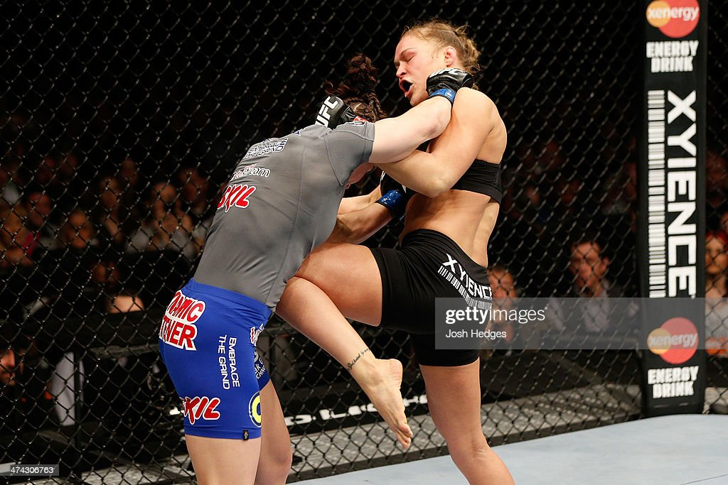 <a gi-track='captionPersonalityLinkClicked' href=/galleries/search?phrase=Ronda+Rousey&family=editorial&specificpeople=3009906 ng-click='$event.stopPropagation()'>Ronda Rousey</a> knees <a gi-track='captionPersonalityLinkClicked' href=/galleries/search?phrase=Sara+McMann&family=editorial&specificpeople=171852 ng-click='$event.stopPropagation()'>Sara McMann</a> in their women's bantamweight championship bout during UFC 170 inside the Mandalay Bay Events Center on February 22, 2014 in Las Vegas, Nevada.