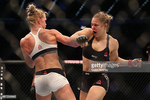 Ronda Rousey of the United States and Holly Holm of the United States compete in their UFC women's bantamweight championship bout during the UFC 193...