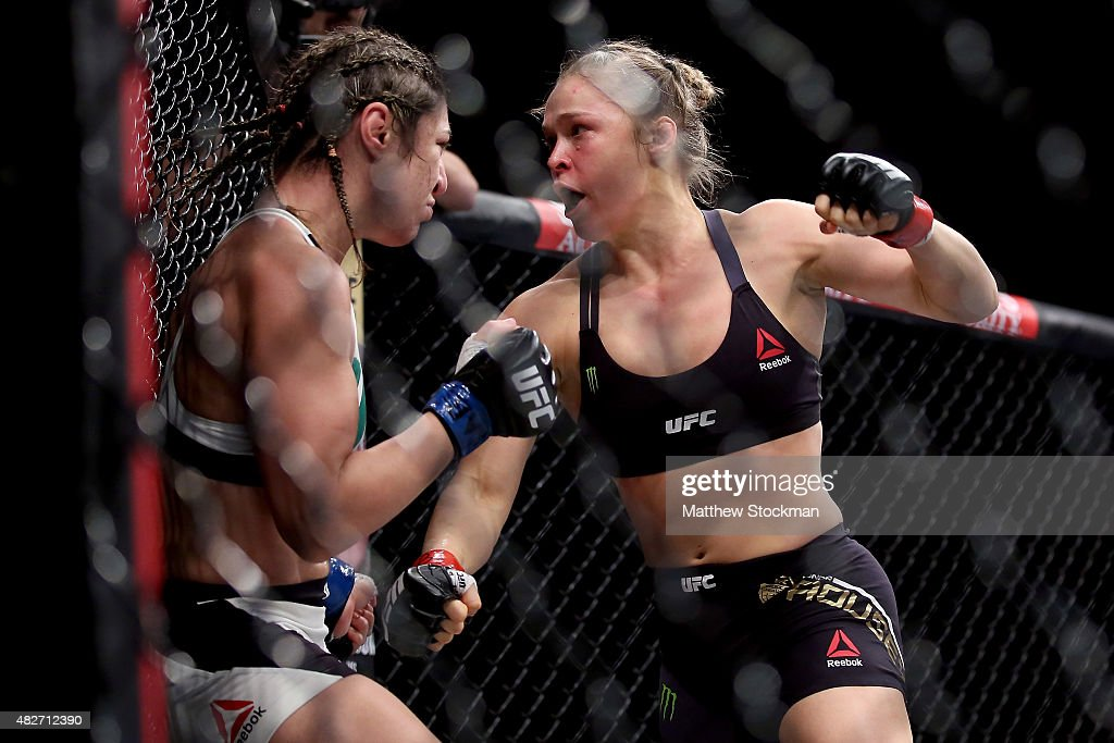 Ronda Rousey of the United States (red) defeats Bethe Correia of Brazi (blue) l in their bantamweight title fight during the UFC 190 Rousey v Correia at HSBC Arena on August 1, 2015 in Rio de Janeiro, Brazil.