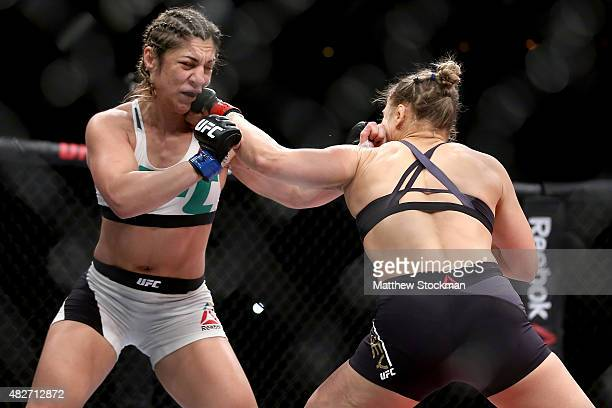 Ronda Rousey of the United States fights Bethe Correia of Brazi l in their bantamweight title fight during the UFC 190 Rousey v Correia at HSBC Arena...