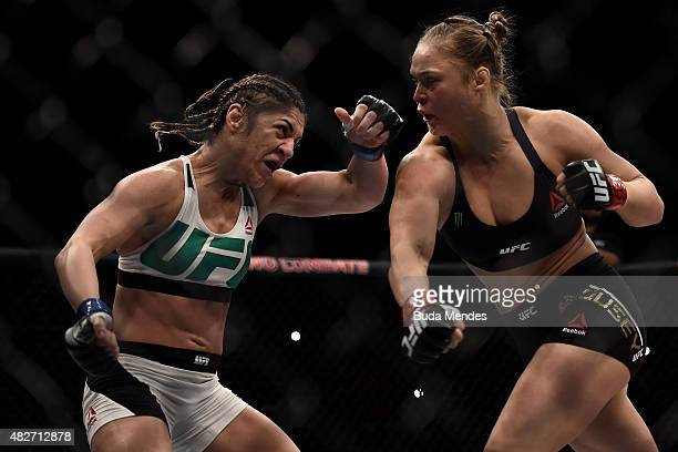 Ronda Rousey of the United States punches Bethe Correia of Brazil in their bantamweight title fight during the UFC 190 Rousey v Correia at HSBC Arena...