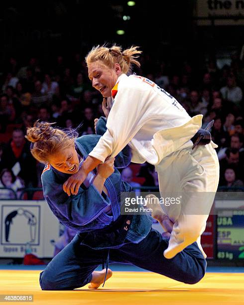 Ronda Rousey of the USA attacks Sara Alvarez of Spain eventually defeating her by ippon to reach the u63kg final and then winning her first World Cup...