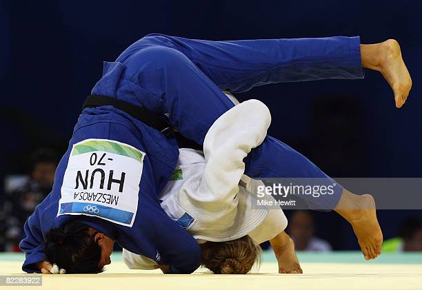 Ronda Rousey of the USA competes against Anett Meszaros of Hungary in their Women's 70 kg Repechage A Final judo bout at the University of Science...