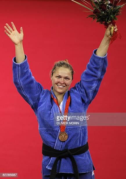 US Ronda Rousey poses with her bronze medal on the podium for the women's 70kg judo competition of the 2008 Beijing Olympic Games on August 13 2008...