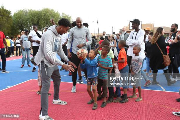 Rondae HollisJefferson of Team World interacts with the children as part of the Basketball Without Borders Africa at the SOS Children's Village on...