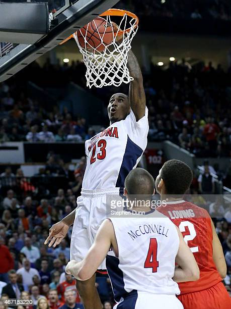 Rondae HollisJefferson of the Arizona Wildcats dunks over Marc Loving of the Ohio State Buckeyes in the second half during the third round of the...