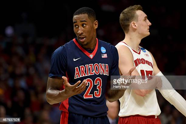 Rondae HollisJefferson of the Arizona Wildcats reacts in the second half while standing alongside Sam Dekker of the Wisconsin Badgers during the West...
