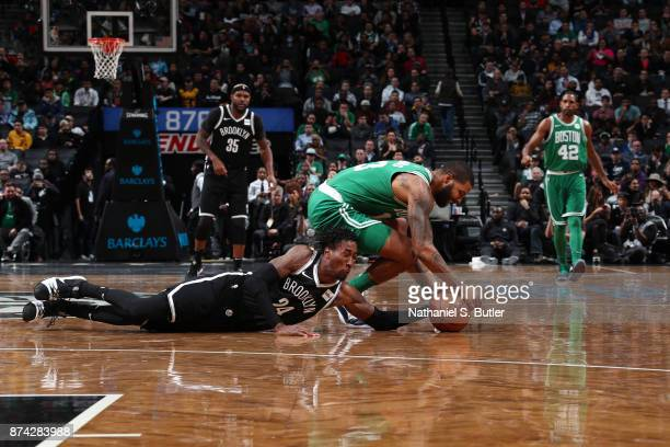 Rondae HollisJefferson of the Brooklyn Nets and Marcus Morris of the Boston Celtics go for the loose ball on November 14 2017 at Barclays Center in...