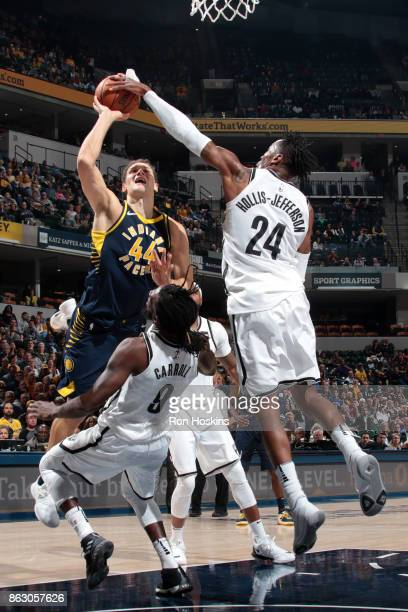 Rondae HollisJefferson of the Brooklyn Nets attempts to block a shot against Bojan Bogdanovic of the Indiana Pacers on October 18 2017 at Bankers...