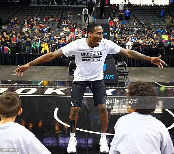 Rondae HollisJefferson of the Brooklyn Nets coaches kids during the Jr NBA clinic on October 11 2015 at Barclays Center in Brooklyn NY NOTE TO USER...