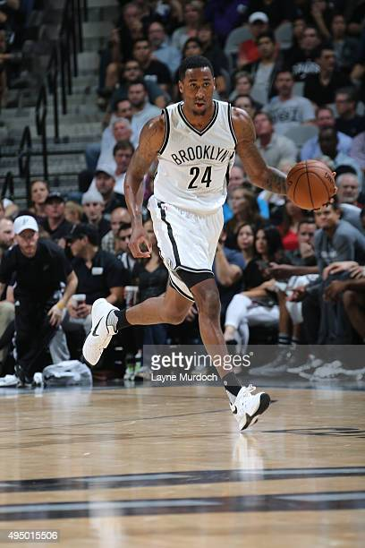Rondae HollisJefferson of the Brooklyn Nets dribbles the ball against the San Antonio Spurs on October 30 2015 at the ATT Center in San Antonio Texas...