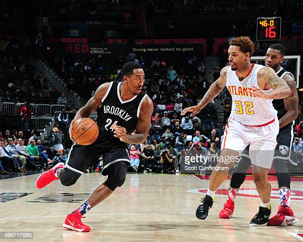 Rondae HollisJefferson of the Brooklyn Nets drives to the basket against Mike Scott of the Atlanta Hawks during the game on November 4 2015 at...