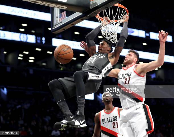 Rondae HollisJefferson of the Brooklyn Nets dunks the ball against Jusuf Nurkic of the Portland Trail Blazers in the first quarter at Barclays Center...