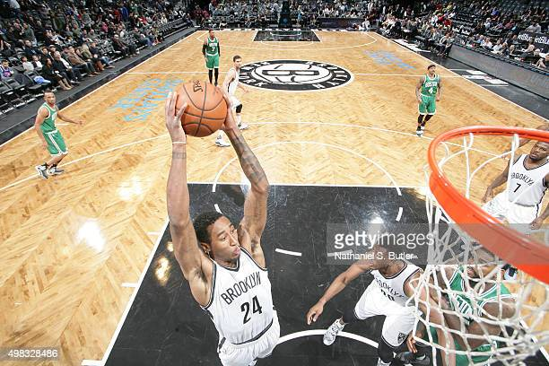 Rondae HollisJefferson of the Brooklyn Nets grabs the rebound against the Boston Celtics on November 22 2015 at Barclays Center in Brooklyn New York...