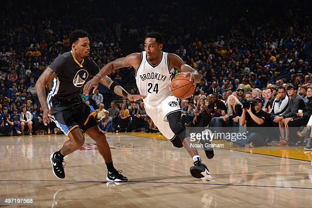 Rondae HollisJefferson of the Brooklyn Nets handles the ball against Brandon Rush of the Golden State Warriors on November 14 2015 at Oracle Arena in...
