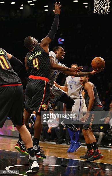 Rondae HollisJefferson of the Brooklyn Nets shoots against Paul Millsap of the Atlanta Hawks during their game at The Barclays Center on November 17...