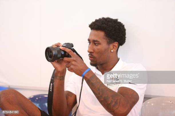 Rondae HollisJefferson of the Brooklyn Nets takes some photos during the Basketball Without Borders Africa at the American International School of...