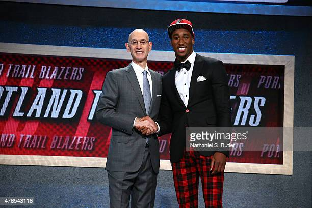 Rondae HollisJefferson shakes hands with NBA Commissioner Adam Silver after being selected number twenty three overall by the Portland Trail Blazers...