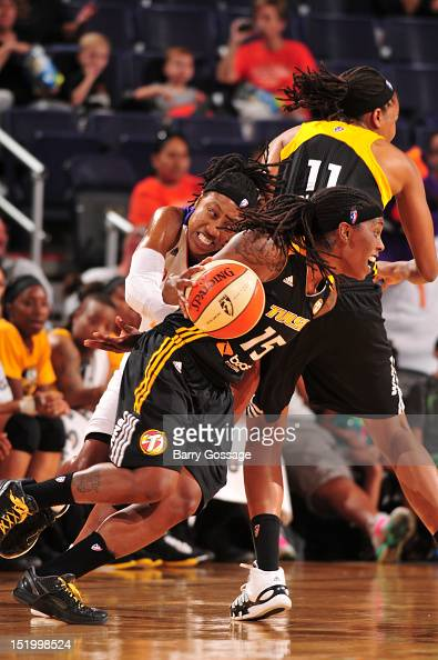 Roneeka Hodges of the Tulsa Shock drives against Alexis Hornbuckle of the Phoenix Mercury on September 14 2012 at US Airways Center in Phoenix...