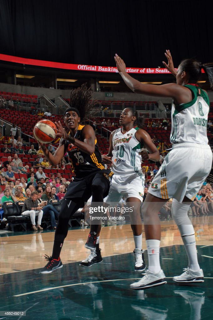 <a gi-track='captionPersonalityLinkClicked' href=/galleries/search?phrase=Roneeka+Hodges&family=editorial&specificpeople=233655 ng-click='$event.stopPropagation()'>Roneeka Hodges</a> #15 of the Tulsa Shock drives to the basket against Shekinna Stricklen #40 and Angel Robinson #8 of the Seattle Storm during the game on August 10,2014 at Key Arena in Seattle, Washington.