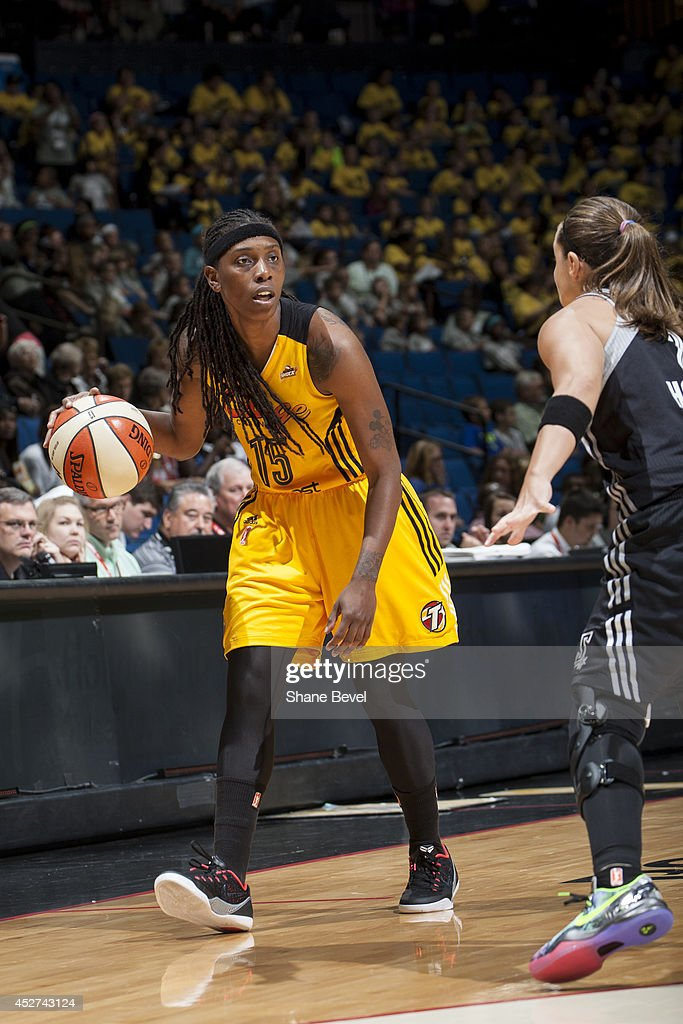 <a gi-track='captionPersonalityLinkClicked' href=/galleries/search?phrase=Roneeka+Hodges&family=editorial&specificpeople=233655 ng-click='$event.stopPropagation()'>Roneeka Hodges</a> #15 of the Tulsa Shock handles the ball against the San Antonio Stars during the WNBA game on July 17, 2014 at the BOK Center in Tulsa, Oklahoma.