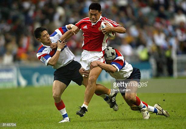 Rong Jing Xiang of Singapore in action against Korea during the Hong Kong World Sevens day two match at Hong Kong Stadium March 27 2004 in Hong Kong