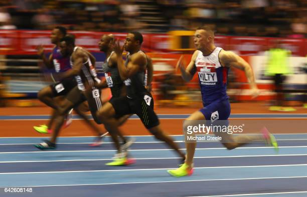 Ronnie Baker of the United States races to the finish line to win the Men's 60 metres final ahead of Richard Kilty of Great Britain and Kim Collins...