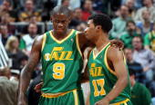 Ronnie Brewer and Ronnie Price of the Utah Jazz talks on the court during the game against the Cleveland Cavaliers at the EnergySolutions Arena on...