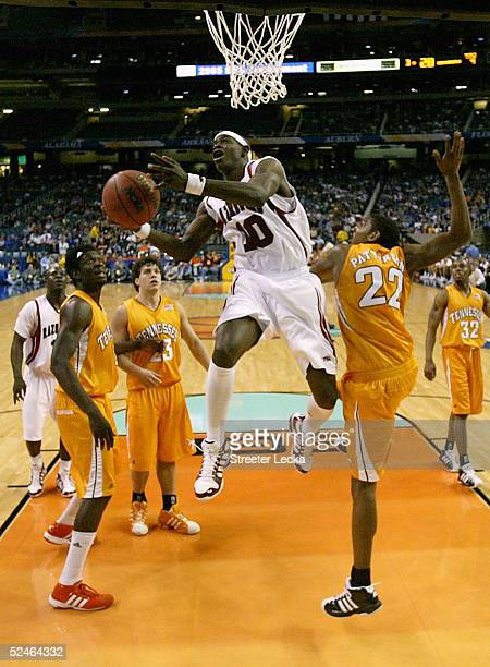 Ronnie Brewer of the Arkansas Razorbacks goes to the basket over Andre Patterson of the Tennessee Volunteers during the first round of the SEC Men's...