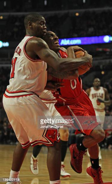 Ronnie Brewer of the Chicago Bulls forces a jump ball while grabbing Jeff Teague of the Atlanta Hawks at the United Center on February 20 2012 in...
