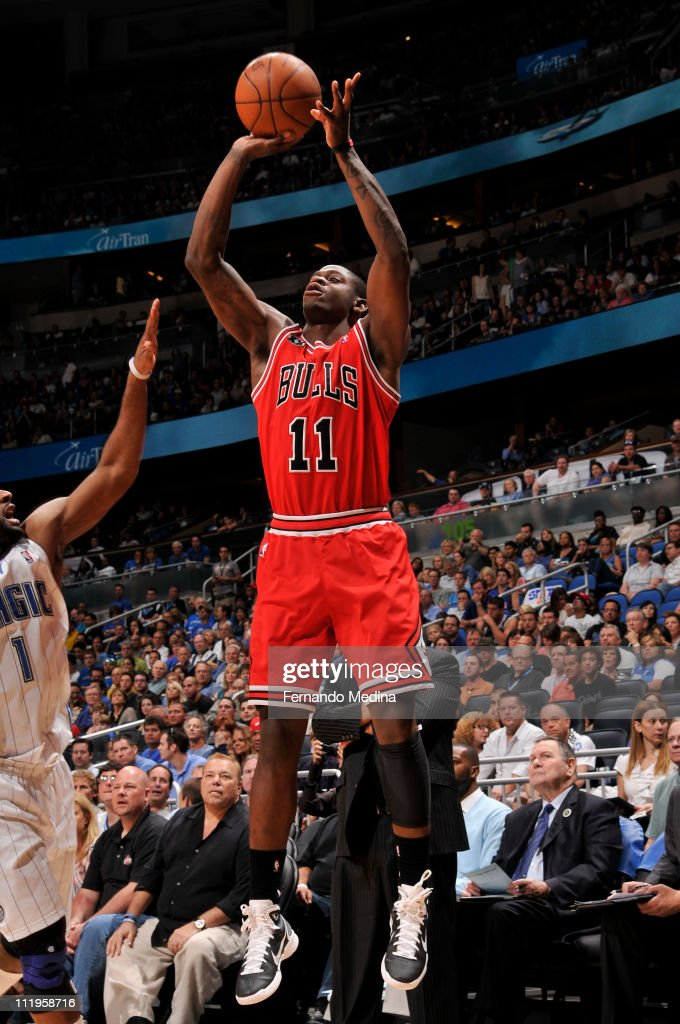 <a gi-track='captionPersonalityLinkClicked' href=/galleries/search?phrase=Ronnie+Brewer&family=editorial&specificpeople=710867 ng-click='$event.stopPropagation()'>Ronnie Brewer</a> #11 of the Chicago Bulls shoots over <a gi-track='captionPersonalityLinkClicked' href=/galleries/search?phrase=Gilbert+Arenas&family=editorial&specificpeople=201742 ng-click='$event.stopPropagation()'>Gilbert Arenas</a> #1 of the Orlando Magic on April 10, 2011 at the Amway Center in Orlando, Florida.