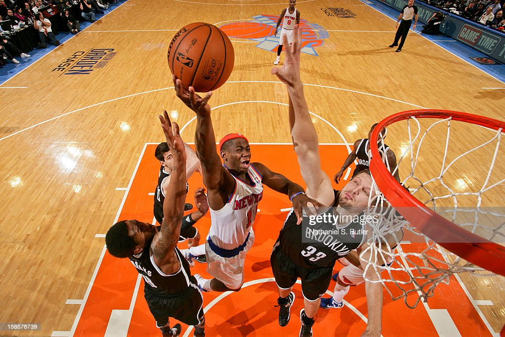 Ronnie Brewer #11 of the New York Knicks drives to the basket against Mirza Teletovic #33 and MarShon Brooks #9 of the Brooklyn Nets on December 19, 2012 at Madison Square Garden in New York City.