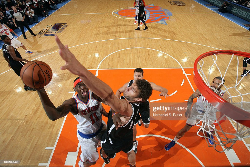 Ronnie Brewer #11 of the New York Knicks drives to the basket against Brook Lopez #11 of the Brooklyn Nets on December 19, 2012 at Madison Square Garden in New York City.