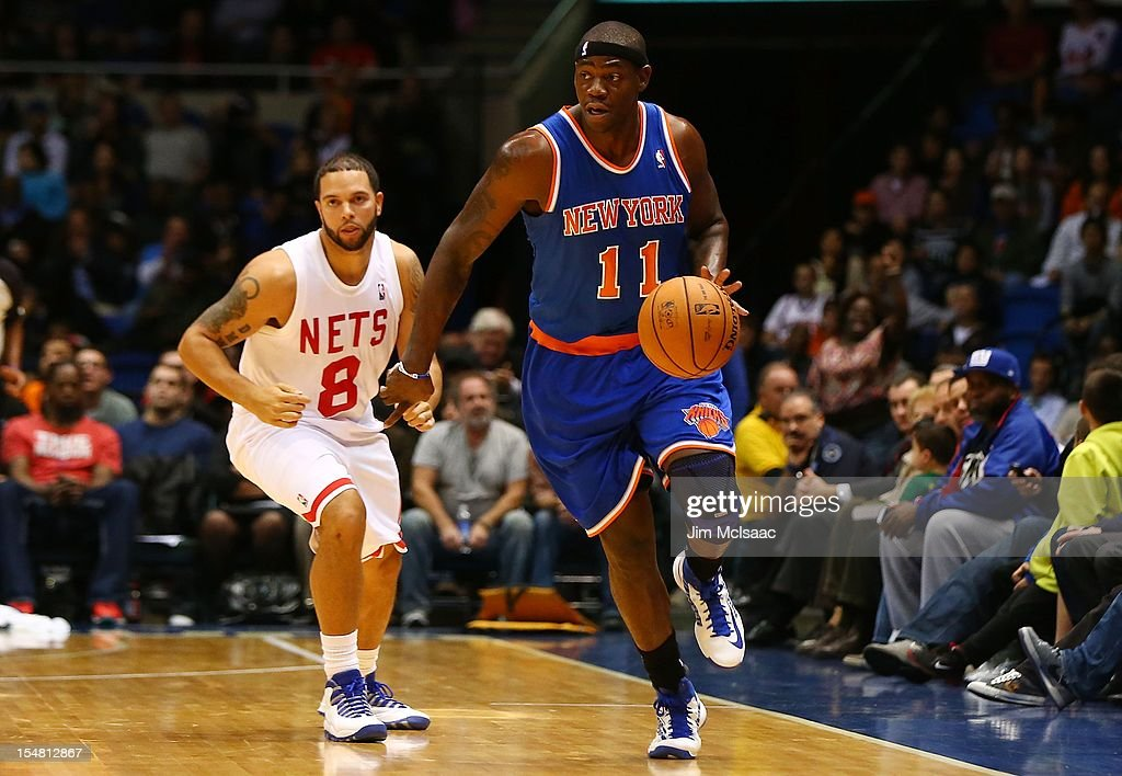 Ronnie Brewer #11 of the New York Knicks in action against Deron Williams #8 of the Brooklyn Nets during a preseason game at Nassau Coliseum on October 24 2012 in Uniondale, New York The Knicks defeated the Nets 97-95.