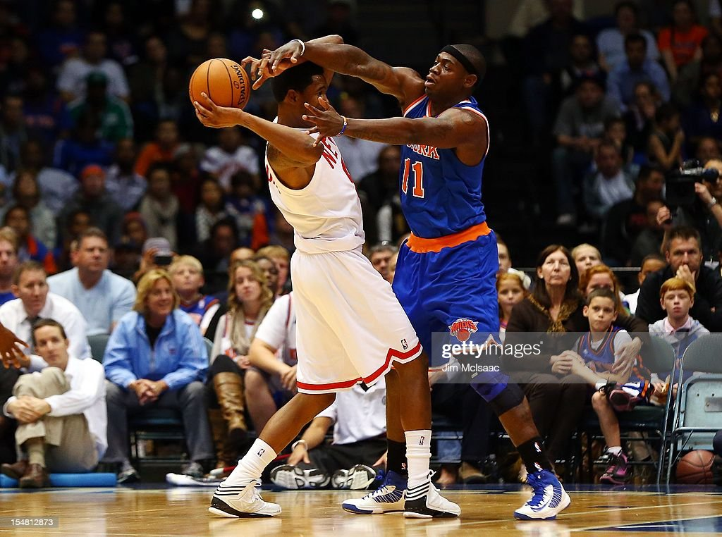 Ronnie Brewer #11 of the New York Knicks in action against MarShon Brooks #9 of the Brooklyn Nets during a preseason game at Nassau Coliseum on October 24 2012 in Uniondale, New York The Knicks defeated the Nets 97-95.