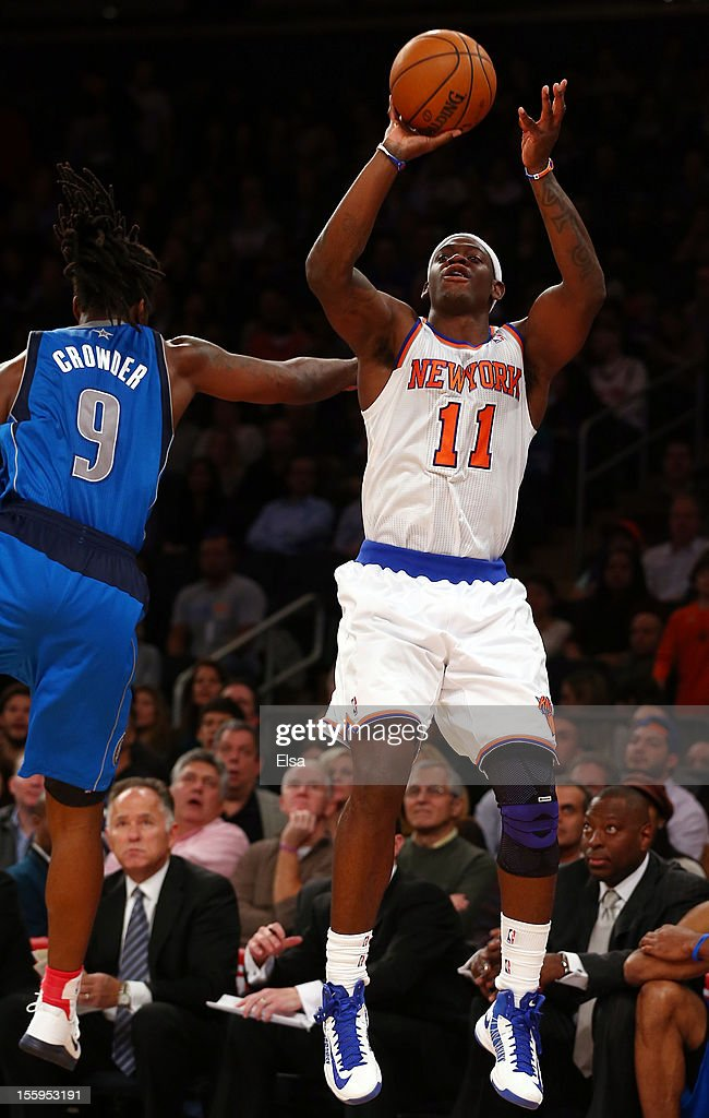 Ronnie Brewer #11 of the New York Knicks takes a shot as Jae Crowder #9 of the Dallas Mavericks defends on November 9, 2012 at Madison Square Garden in New York City.The New York Knicks defeated the Dallas Mavericks 104-94.