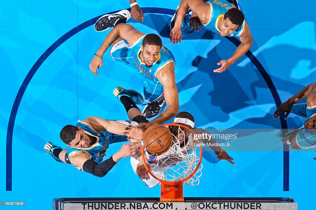 Ronnie Brewer #8 of the Oklahoma City Thunder shoots a layup against Austin Rivers #25 of the New Orleans Hornets on February 27, 2013 at the Chesapeake Energy Arena in Oklahoma City, Oklahoma.