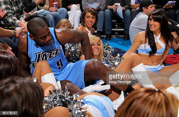 Ronnie Brewer of the Utah Jazz picks himself up after crashing into the Denver Nuggets dance team on the baseline as they Jazz face the Nuggets...