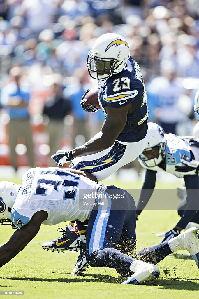 <a gi-track='captionPersonalityLinkClicked' href=/galleries/search?phrase=Ronnie+Brown&family=editorial&specificpeople=228574 ng-click='$event.stopPropagation()'>Ronnie Brown</a> #23 of the San Diego Chargers is tackled by <a gi-track='captionPersonalityLinkClicked' href=/galleries/search?phrase=Bernard+Pollard&family=editorial&specificpeople=630572 ng-click='$event.stopPropagation()'>Bernard Pollard</a> #31 of the Tennessee Titans at LP Field on September 22, 2013 in Nashville, Tennessee. The Titans defeated the Chargers 20-17.