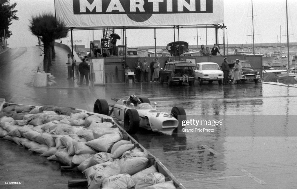 Ronnie Bucknum of the United States drives the Honda Research Development Co Honda RA272 Honda V12 during a wet practice for the Monaco Grand Prix on...