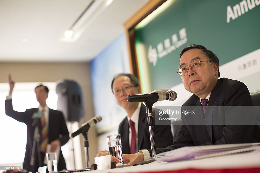 Ronnie Chan, chairman of Hang Lung Properties Ltd., right, and Philip Chen, managing director, center, listen during a news conference in Hong Kong, China, on Thursday, Jan. 31, 2013. Hang Lung, the Hong Kong developer investing more than $8.5 billion building malls in mainland China, said 2012 underlying profit almost doubled after the company sold more properties in the city. Photographer: Jerome Favre/Bloomberg via Getty Images
